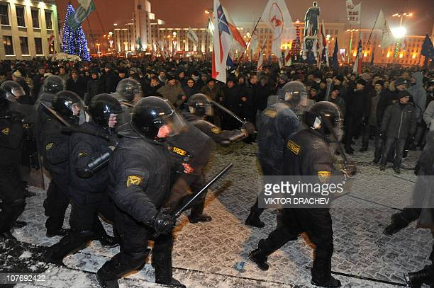Protesters clash with riot police during an opposition rally in Minsk early on December 20, 2010. Belarus police arrested hundreds of protestors as...