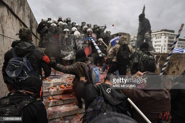 Protesters clash with riot police in Athens on January 20 2019 during a demonstration against the agreement with Skopje to rename neighbouring...