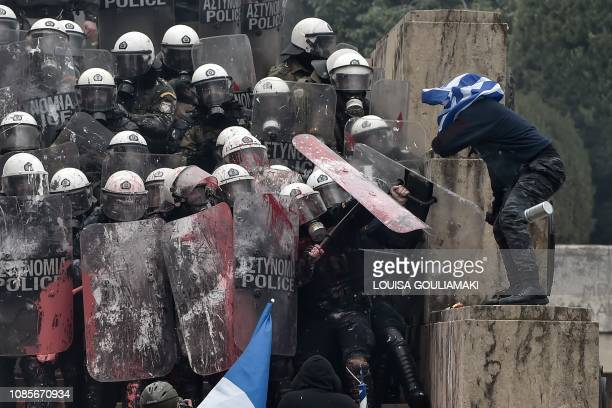 Protesters clash with riot police in Athens, on January 20 during a demonstration against the agreement with Skopje to rename neighbouring country...