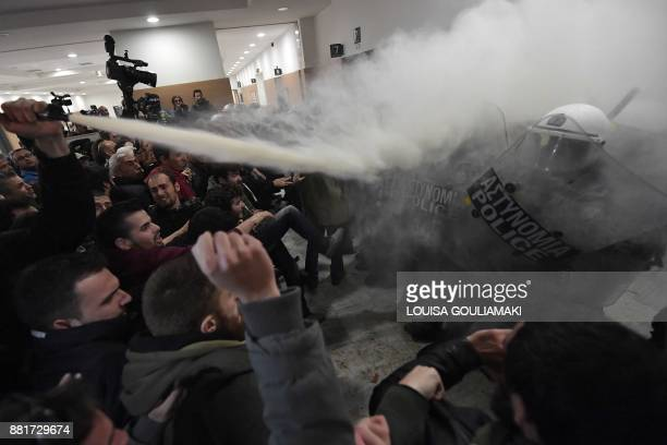 TOPSHOT Protesters clash with riot police in the lobby of a courtroom in Athens on November 29 2017 People protesting homes' auctions clashed with...