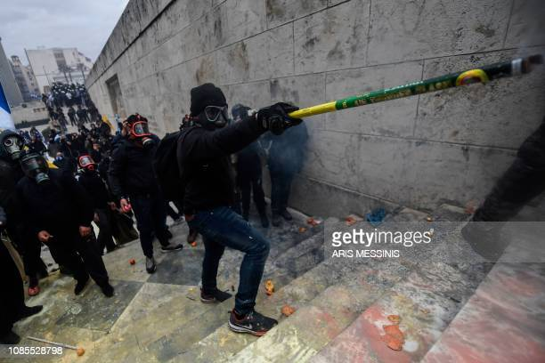Protesters clash with riot police near the Greek Parliament in Athens on January 20 2019 during a demonstration against the agreement with Skopje to...