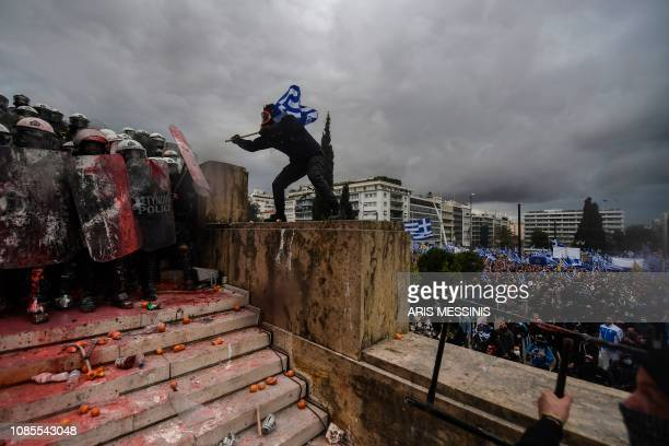 TOPSHOT Protesters clash with riot police near the Greek Parliament in Athens on January 20 2019 during a demonstration against the agreement with...