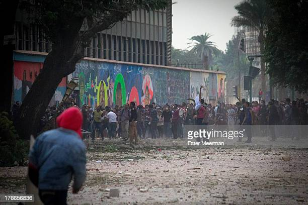 Protesters clash with riot police on Mohammed Mahmoud street in downtown Cairo, during the first anniversary of the Mohammed Mahmoud clashes on the...