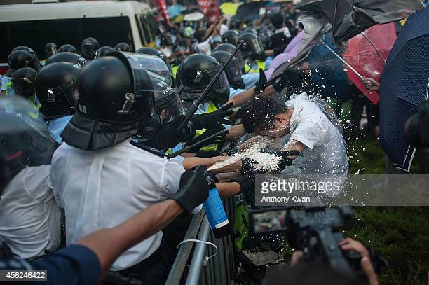 Protesters clash with riot police on September 27 2014 in Hong Kong Thousands of people kicked off Occupy Central by taking over Connaught Road one...