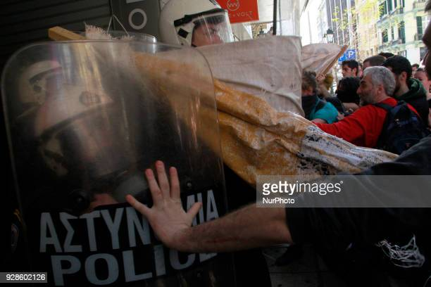 Protesters clash with riot policemen during a demonstration against property auctions Thessaloniki on March 7 2018