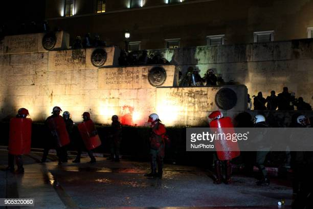 Protesters clash with riot policemen during a demonstration by Greek Unions outside the Greek Parliament against the new reforms on property auctions...