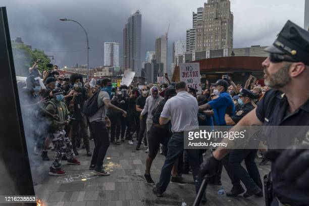 Protesters clash with security forces as they gather for a rally held against police killing of George Floyd in Minneapolis at Barclays Center in New...