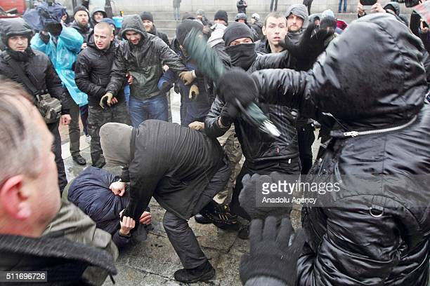 Protesters clash with security forces during an antigovernment protest at Independence Square in Kiev Ukraine on February 22 2016 Protesters of the...