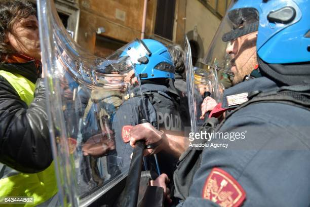 Protesters clash with security forces during taxi drivers' strike to protest the amendment on app-based car transport company Uber in Rome, Italy on...