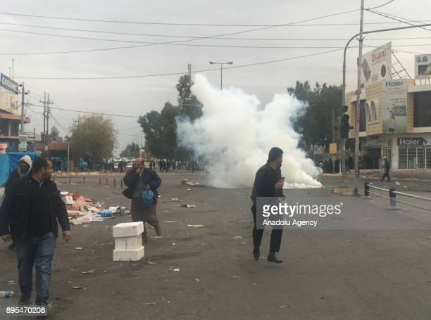 Protesters clash with security forces during the antigovernment protests in Sulaymaniyah in Sulaymaniyah Iraq on December 19 2017