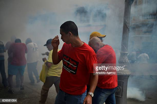 Protesters clash with the Military Police during a demonstration staged against the bill that freezes government spending for 20 years, on November...