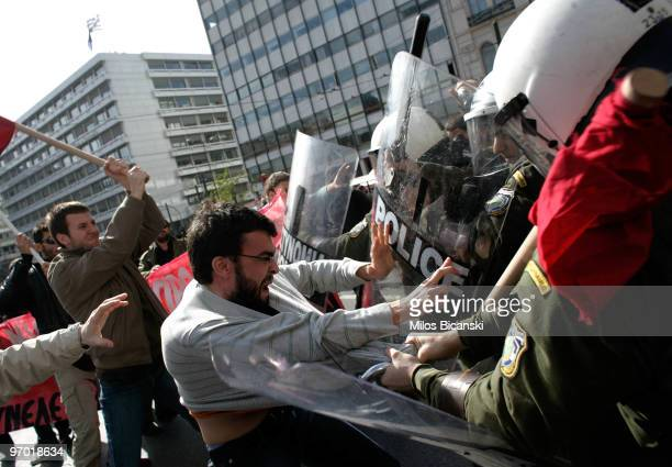 Protesters clash with the police during a protest march to mark a 24hour general strike on February 24 2010 in Athens Greece Greece ground to a halt...