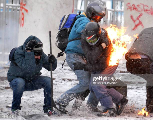 Protesters clash with the police in the center of Kiev on January 22 2014 Ukrainian police on Wednesday stormed protesters' barricades in Kiev as...