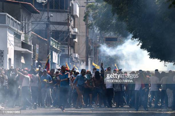 Protesters clash with the security forces in a demonstration against the government of Nicolas Maduro in San Antonio del Tachira Venezuela on...