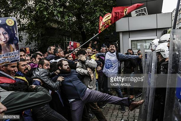 Protesters clash with Turkish riot police during a demonstration on October 13, 2015 in Istanbul against the deadly attacks in Ankara. The double...