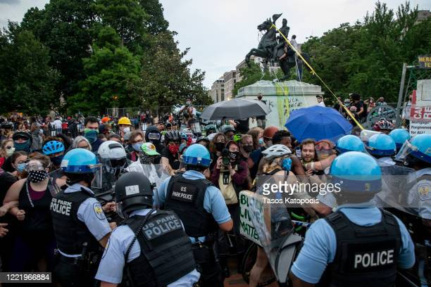 Protesters clash with US Park Police after protesters attempted to pull down the statue of Andrew Jackson in Lafayette Square near the White House on...