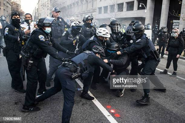 Protesters clash with Washington DC Police at Black Lives Matter Plaza on December 12, 2020 in Washington, DC. Thousands of protesters who refuse to...