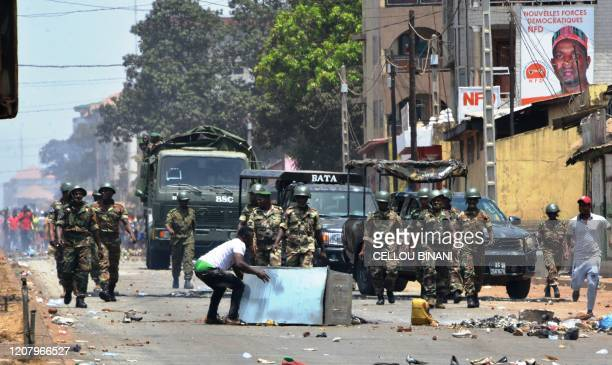 Protesters confornt the army in the streets in Conakry on March 22 during a constitutional referendum in the country Guinean President Alpha Condé...