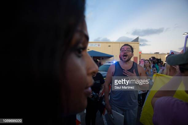 Protesters confront each other outside the Broward County Supervisor of Elections office on November 9 2018 in Lauderhill Florida According to...