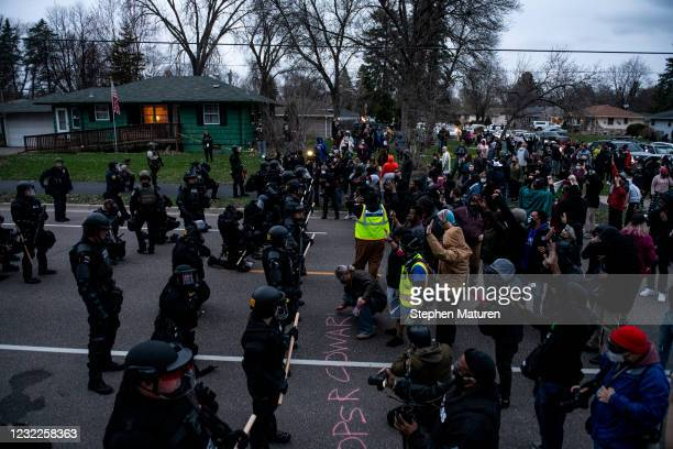 Protesters confront law enforcement on April 11, 2021 in Brooklyn Center, Minnesota. A crowd gathered after Brooklyn Center police shot and killed...
