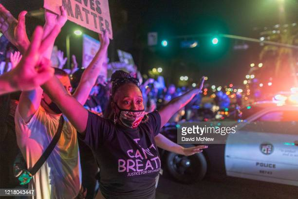 Protesters confront police as demonstrations continue over the killing of George Floyd despite the dangers of the widening coronavirus pandemic on...