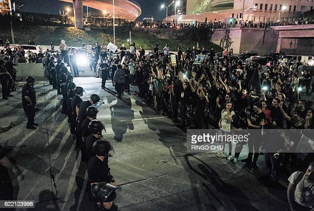 Protesters confront police as they shut down the 101 Freeway a major thoroughfare in the city following a rally to protest a day after Presidentelect...