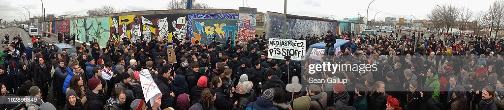 Protesters confront police at the East Side Gallery, which is the longest still-standing portion of the former Berlin Wall, during efforts by a construction company to remove a 25-meter long section of the Wall on March 1, 2013 in Berlin, Germany. A real estate developer is planning to build a 14-storey apartment building between the Wall and the Spree River, and needs to remove the Wall section in order to allow access to the construction site. Critics, including East Side Gallery mural artists and Spree River embankment development opponents, decry the move, citing the importance of the East Side Gallery's status as a protected landmark and a major tourist attraction. The East Side Gallery is approximately 1.3 kilometers long.