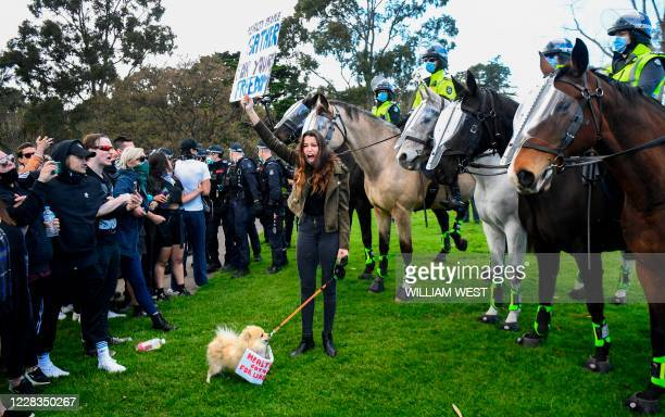 Protesters confront police at the Shrine of Remembrance in Melbourne on September 5 during an anti-lockdown rally protesting the state's strict...