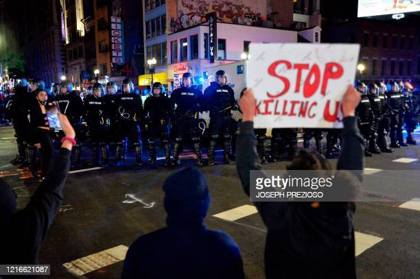 Protesters confront police during clashes after a demonstration over the death of George Floyd an unarmed black man who died in Minneapolis Police...