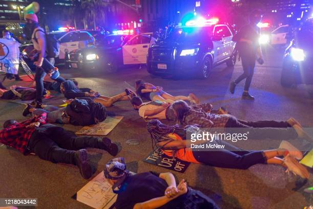Protesters confront police in the position that George Floyd was in when he died as demonstrations continue over the killing of George Floyd despite...