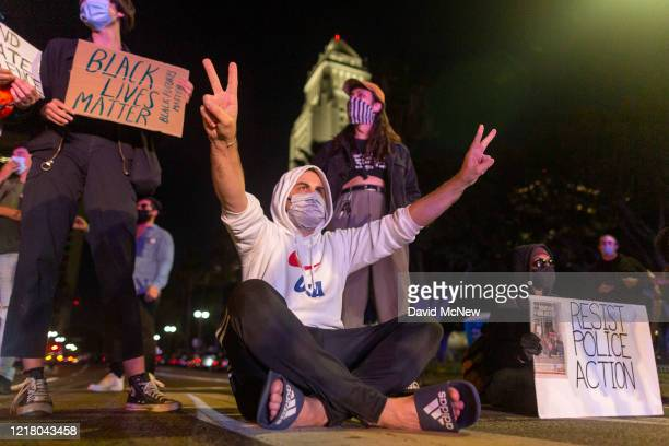 Protesters confront police near City Hall as demonstrations continue over the killing of George Floyd despite the dangers of the widening coronavirus...