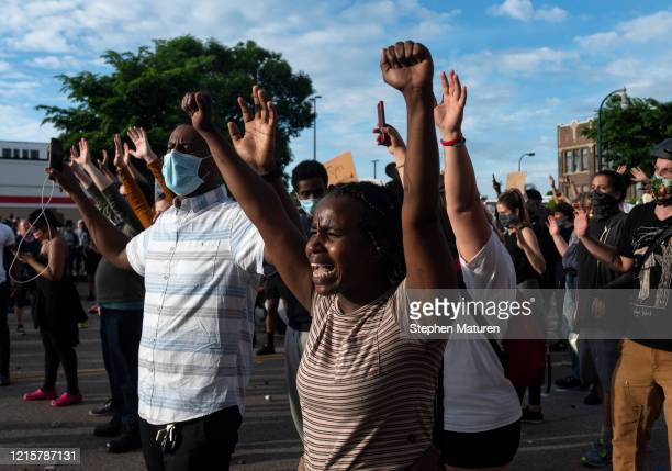 Protesters confront police outside the 3rd Police Precinct on May 27 2020 in Minneapolis Minnesota Four Minneapolis police officers have been fired...