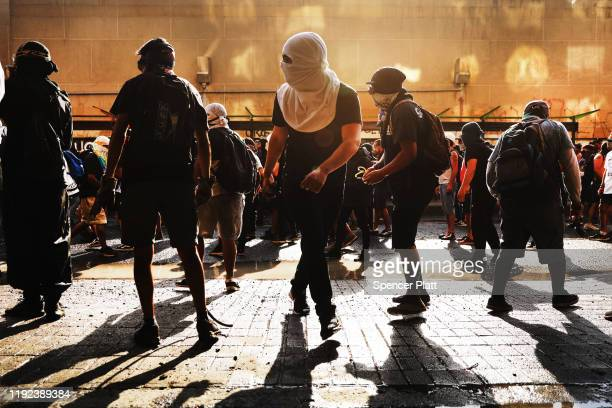 Protesters confront riot police as demonstrations continue against Chilean President Sebastian Piñera the 50th consecutive day of unrest on December...