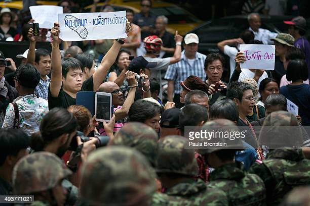 BANGKOK THAILAND MAY 25 Protesters confront Thai military during an anticoup protest on the third day of the military coup May 25 2014 in Bangkok...