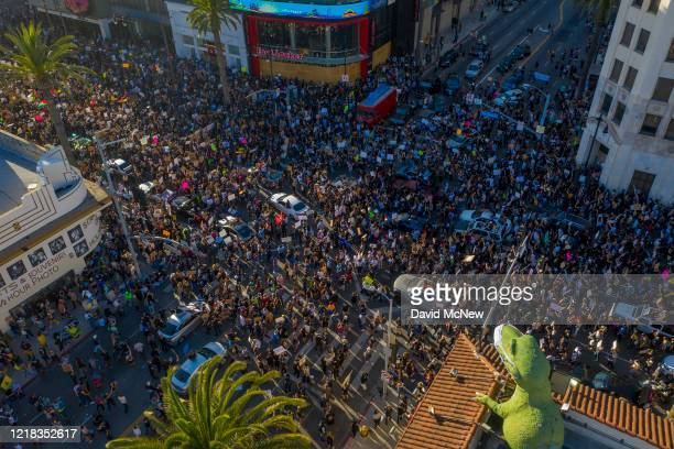 Protesters congregate at the Hollywood and Highland intersection as demonstrations continue over the killing of George Floyd despite the dangers of...