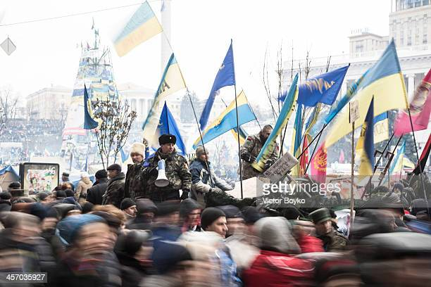 Protesters control the flow of people in and out Maidan Square on December 15 2013 in Kiev Ukraine The antigovernment protesters are demanding the...