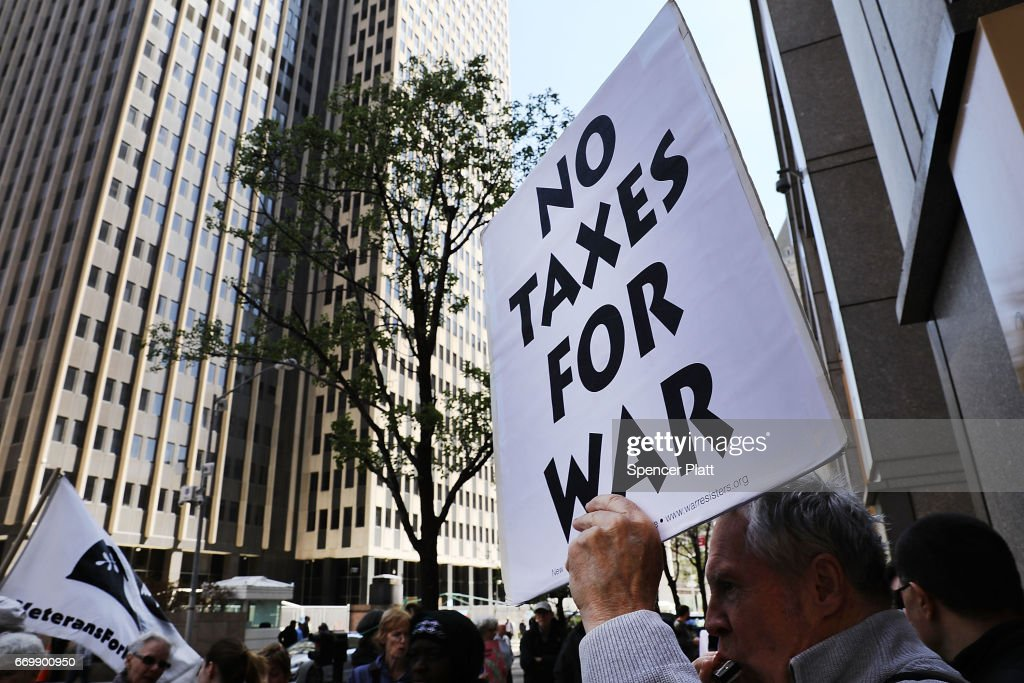 Activists Protest Tax Dollars Being Spent On U.S. Wars At NYC IRS Building : News Photo