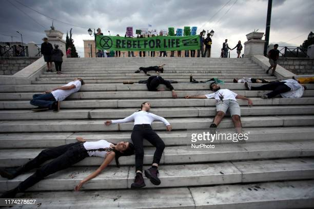 Protesters covered with oil during a demonstration in Syntagma Square in Athens city centre by Extinction Rebellion group against climate change in...