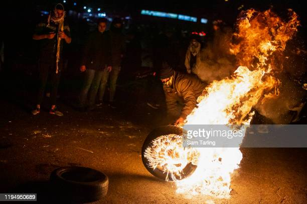 Protesters create a road block with burning tires on December 19, 2019 in Beirut, Lebanon. Protesters were unhappy with the selection of Hezbollah...
