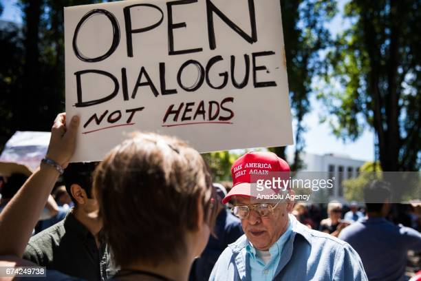 Protesters create dialogue during a proDonald Trump rally at Martin Luther King Jr Civic Center Park in Berkeley California on April 27 2017 The...