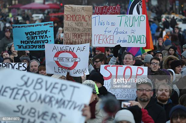 Protesters critical of the recent election of Donald Trump as US president gather for a demonstration near the Brandenburg Gate on November 12 2016...