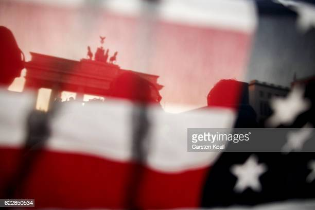 Protesters critical of the recent election of Donald Trump as US President gather for a demonstration near the Brandenburg Gate on November 12, 2016...