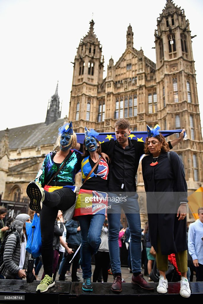 Protesters dance as they demonstrate against the EU referendum result outside the Houses of Parliament on June 28, 2016 in London, England. Up to 50,000 people were expected before the event was cancelled due to safety concerns. In the early evening a crowd still convereged on the square to vent their anti-Brexit feelings, before the protest moved to the Houses of Parliament.