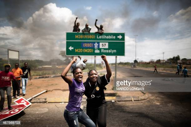 Protesters dance at a crossroad in Hebron near Pretoria on February 7 2014 during a protest for basic government services South African police fired...