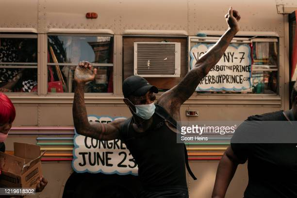 Protesters dance during a block party and march led by musician and New York congressional candidate Paperboy Prince in the borough of Brooklyn on...
