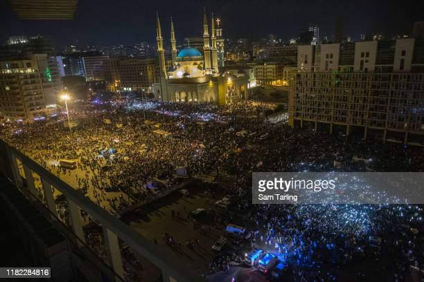 Protesters dance during an anti-government demonstration in central Beirut on October 20, 2019 in Beirut, Lebanon. This is the largest gathering yet...