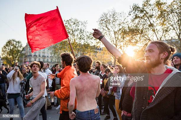 Protesters dancing during a May Day rally in Paris, France
