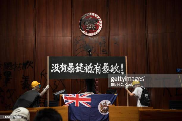 Protesters deface the Hong Kong logo at the Legislative Council to protest against the extradition bill on July 1 2019 in Hong Kong China Thousands...