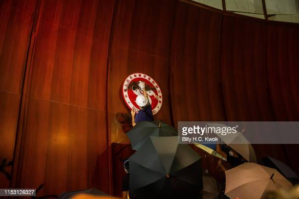 Protesters deface the Hong Kong logo at the Legislative Council to protest against the extradition bill on July 01 2019 in Hong Kong China Thousands...