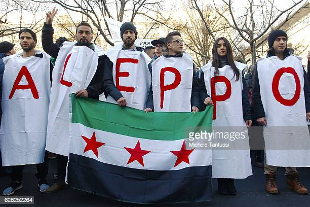 Protesters demand an end to Russian aerial bombing of the Syrian city of Aleppo in front of the Russian Embassy on December 7 2016 in Berlin Germany...